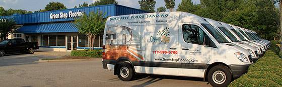 wide shot of Green Step Flooring vans